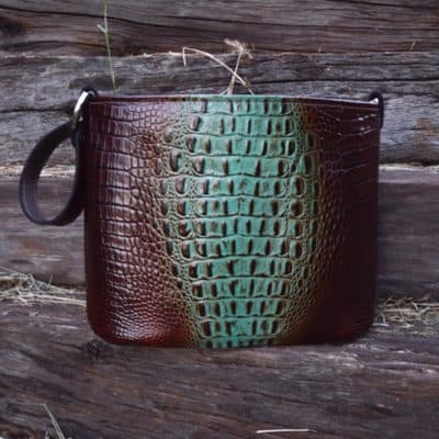 Brown and teal croc embossed bucket concealed pistol handbag