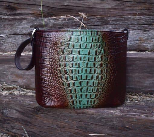 Brown and teal croc embossed bucket concealed pistol handbag