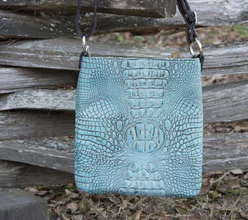 Concealed pistol purse in crocodile embossed leather, antique turquoise color