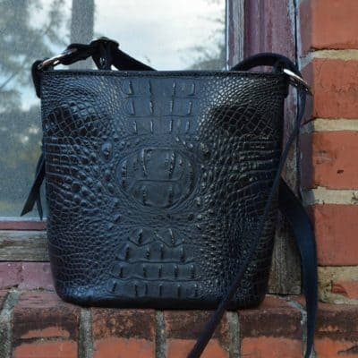 Embossed crocodile concealed carry purse in black.