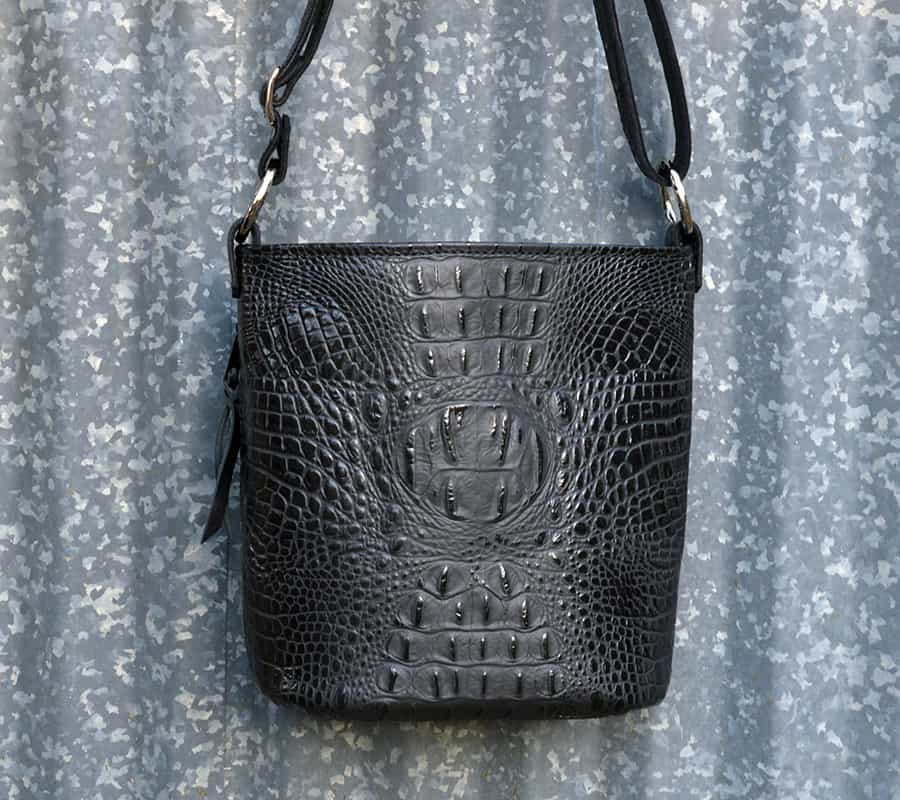 Conceal carry pistol purse in classic black crocodile.