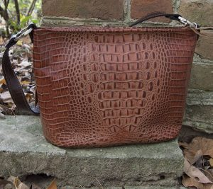 Papaya colored crocodile leather conceal carry pistol purse