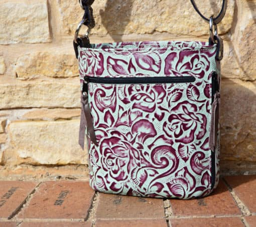 Back side of Bucket style Turquoise rose concealed carry purse
