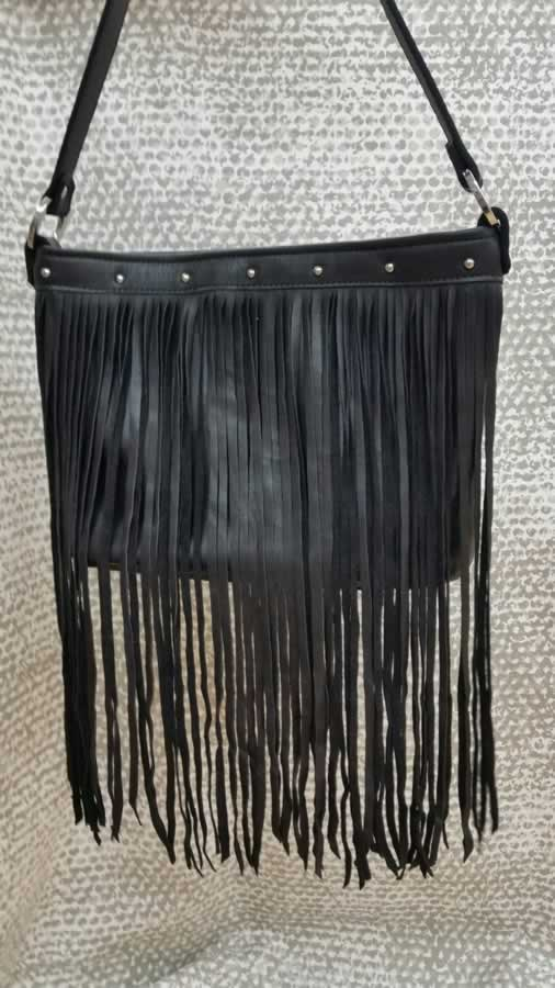 Top grain leather with silver spots and fringe